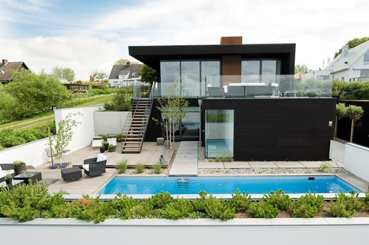 Nilsson Villa Modern Beach House With Black and White Interior Design in Sweden homesthetics 2